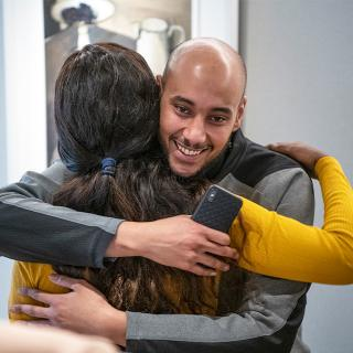 Ahmed Leap Trainer hugging a colleague